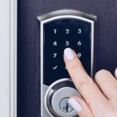 woman-s-hand-is-pressing-numbers-on-an-electronic-keypad-to-open-the-door-of-a-house_t20_XxK7o3